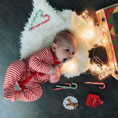 Child Childhood One Person Indoors  Innocence Cute Young Baby High Angle View Christmas Christmas Decoration Christmas Lights Baby In Red Clothes Babyhood Newborn Cute Boy Boy 4 Months Old Real People Home Interior Portrait Holiday Celebration