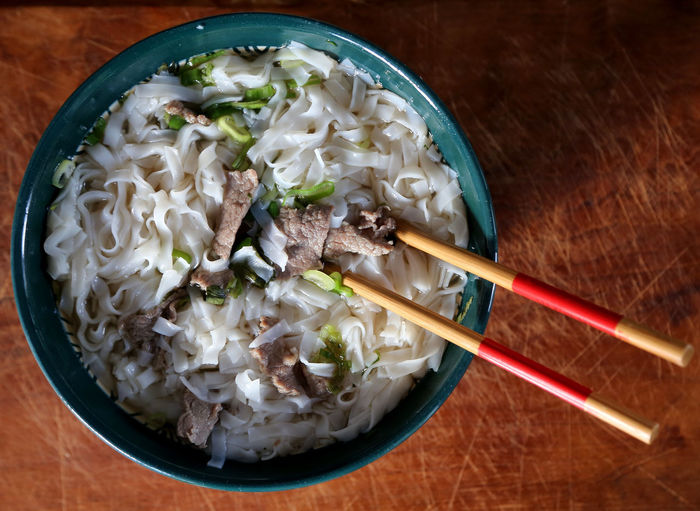 Pho Soup, Vietnamese Cuisine Vietnamese Food Bean Sprout Bowl Chinese Food Chopsticks Close-up Day Food Food And Drink Freshness Healthy Eating High Angle View Indoors  Japanese Food No People Noodle Soup Noodles Pho Soup Ready-to-eat Soup Table Vietnamese Soup Fried Rice Indoors  Ramen Noodles