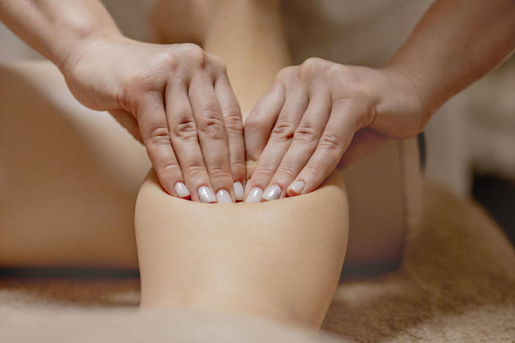 Midsection of woman doing therapy at spa