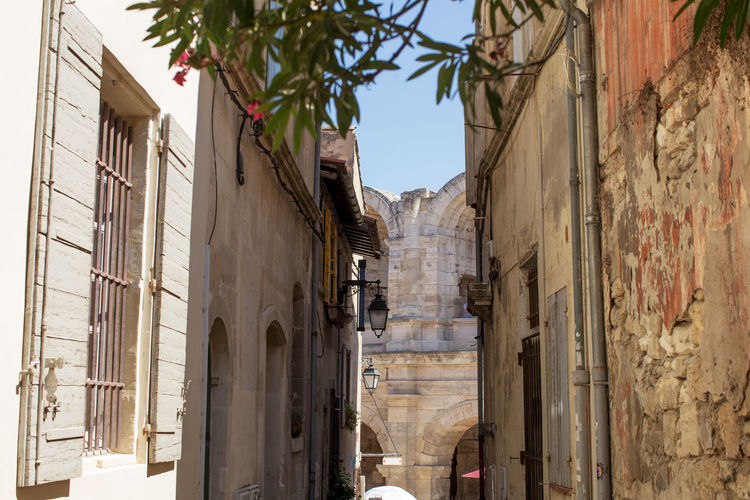 High section of buildings and the Arles Amphitheatre, a Roman arena. Architecture Branch Building Exterior Built Structure City Day Long Narrow No People Old Town Outdoors Sky Tourism Town Travel Destinations