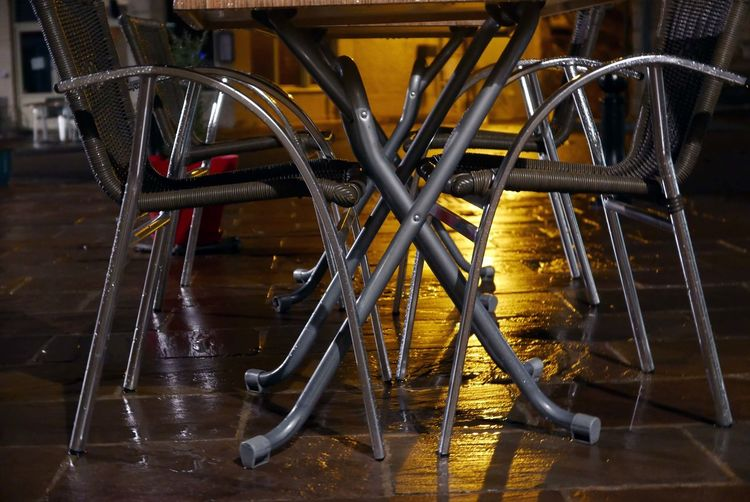 Absence Empty Metal Outdoor Restaurant At Night France Table Chairs Reflection After Rain Wet
