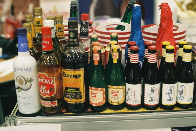 Film Nikon Alcohol Arrangement Bottle Choice Collection Container Drink Film Photography Food And Drink For Sale Glass - Material In A Row Indoors  Large Group Of Objects Multi Colored Order Refreshment Retail  Sale Side By Side Text Variation