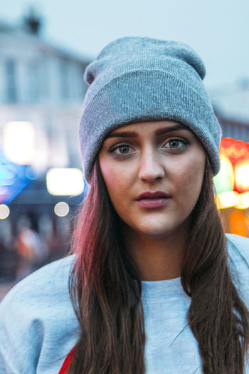 Portrait of young woman wearing knit hat