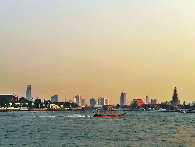 Urban Skyline Cityscape Skyscraper City Modern Water Architecture Travel Destinations No People Nautical Vessel Sunset Sea Outdoors Sky Day Journey Famous Place Bangkok Thailand. Photography Vacations Architecture