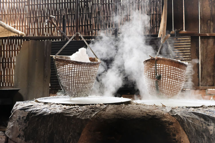 Selective salt in basket is hungover stove is product of salty water from underground in mountains.