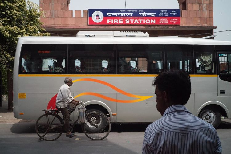 Delhi 2017 Delhi India Architecture Building Exterior Candid Communication Day Fire Land Vehicle Lifestyles Men Mode Of Transport Occupation One Person Outdoors People Real People Streetphotography Text Transportation