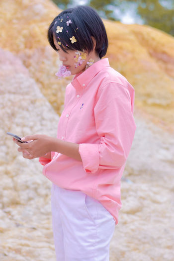 Midsection of woman holding smart phone