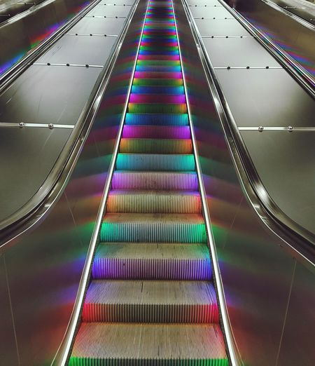 Technology Escalator Colorful Steps Moving Up Railing Indoors  Multi Colored Stockholm