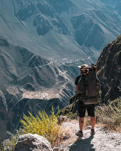 The beautiful way down the Colca Canyon. Nature Outdoors Adventure South America Latin America Explore Discover  Camping Backpacking Backpack Canyon River Leisure Activity Hiking Activity Rear View Mountain Real People Non-urban Scene Mountain Range One Person Lifestyles Young Adult Standing Formation