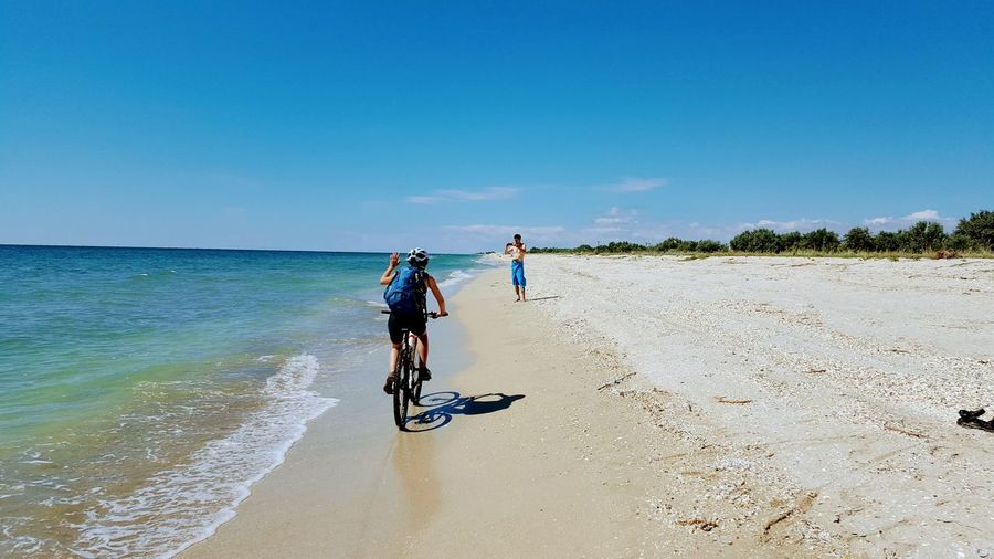 love Clear Sky Sea Full Length Beach Sand Water Headwear Bicycle Blue Sky Cycling Shore Cycling Helmet Sandy Beach Riding Calm Scenics Horizon Over Water Tranquil Scene Friend