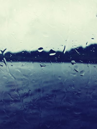 Full Frame Drop Backgrounds Window Glass - Material Wet Water Rain Glass No People Condensation Indoors  Close-up RainDrop Day Nature Sky Freshness Boat Rain Dark Weather