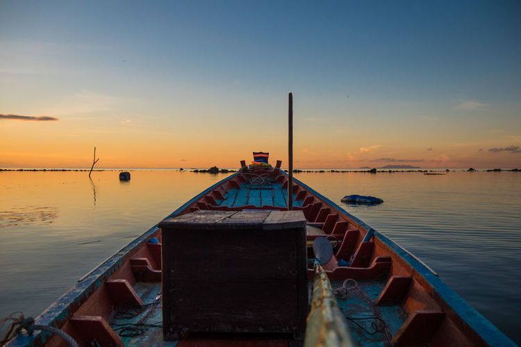 Fisherboat during sunset Thailand Boat Fisherboat Horizon Over Water No People Orangeandblue Outdoors Reflection Sunset Symmetry Tranquil Scene Water