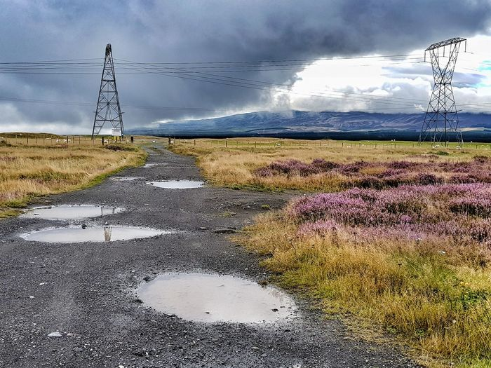 Paused to soak up the drama in the Desert Road. Rural Scene Storm Cloud Electricity Pylon Water Electricity  Technology Sky Landscape Cloud - Sky Grass Dramatic Sky Power Line  Atmospheric Mood Scenics Tranquil Scene Moody Sky Overcast