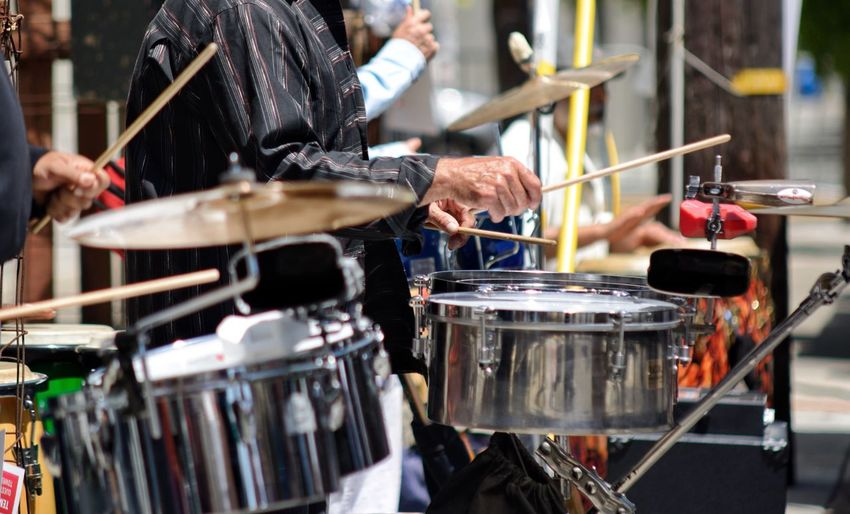 Close-Up Of Man Playing Drums