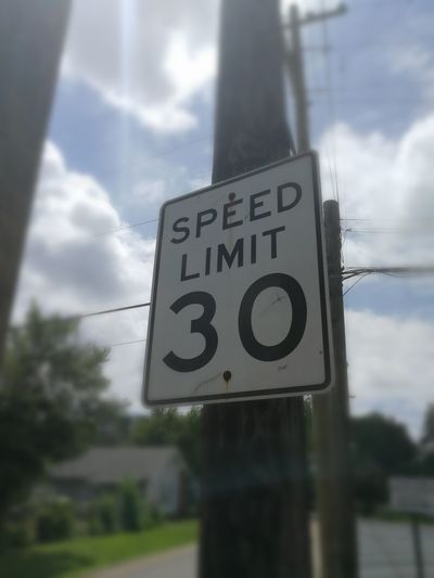 Speed limit 30 sign (American style) 30 Speed Limit Road Sign Communication Speed Limit Sign Guidance Text Warning Sign Sky Close-up Cloud - Sky