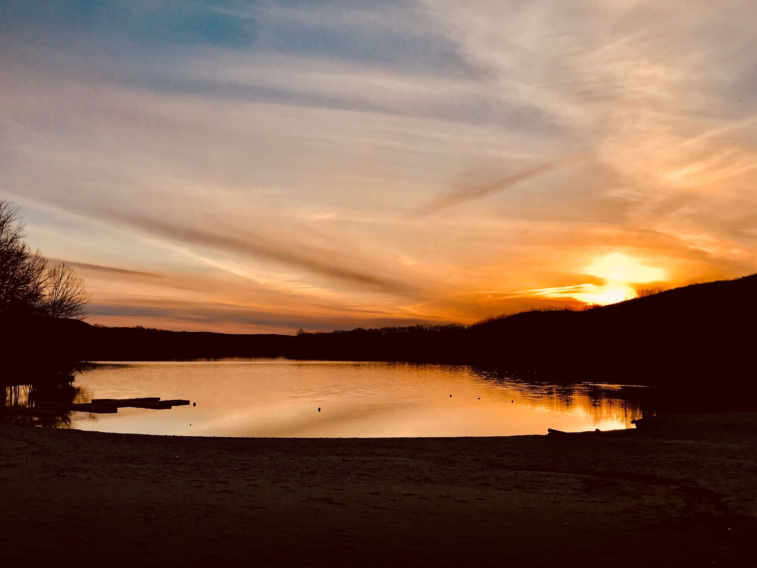 water, sky, sunset, scenics - nature, tranquility, tranquil scene, beauty in nature, cloud - sky, lake, nature, silhouette, orange color, beach, reflection, no people, idyllic, land, non-urban scene, outdoors