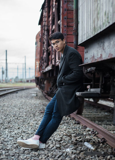 Portrait Of Young Man Leaning On Train