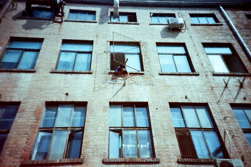Out standing BEIJING北京CHINA中国BEAUTY building exterior Low Angle View Built Structure Architecture 798 District 798artzone Beijing, China Traveling In China Travelphotography Workers At Work ExploreEverything Lomography Ektar 100 Ishootfilm