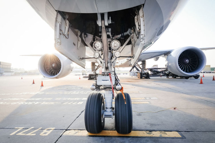 Airliner gear Boeing 777 Aerospace Industry Air Vehicle Airplane Airport Airport Runway Commercial Airplane Day Engine Jet Engine Land Vehicle Mode Of Transportation Outdoors Runway Stationary Sunlight Tire Transportation Travel Vehicle Part Wheel