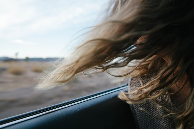 Hair Car Car Interior Close-up Day Headshot Land Vehicle Lifestyles Mode Of Transport Motion One Person Outdoors People Real People Road Trip Sky Transportation Vehicle Interior Water Wind Window Windshield Young Adult The Week On EyeEm Editor's Picks