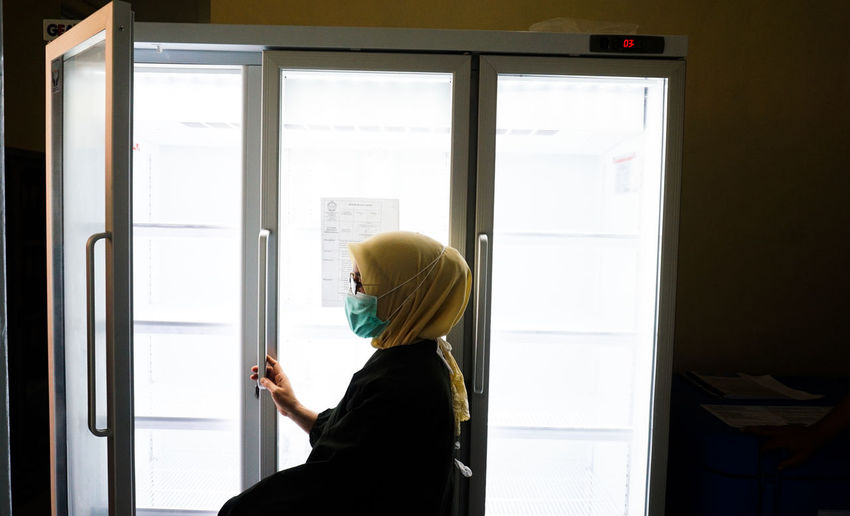 Health worker in the cold room for the covid-19 vaccine at one of the hospitals