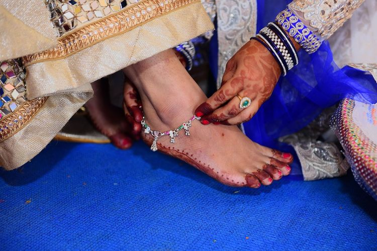 Woman wearing anklet on bride ankle