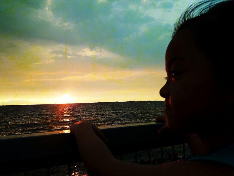 Beautiful sunset Child Girl Manila Philippines EyeEmNewHere EyeEm Nature Lover Eyeem Philippines Beauty Horizon Over Water One Person Sunset Cloud - Sky Sea Headshot People