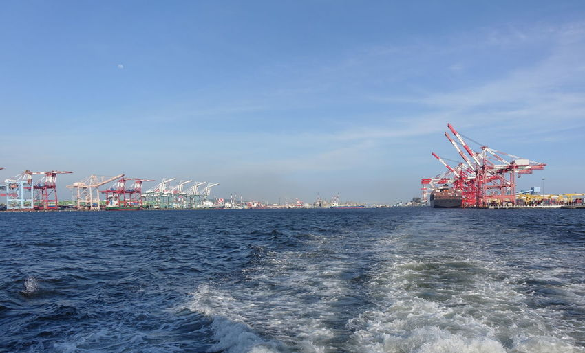 Panoramic view of the Kaohsiung container port in Taiwan Container Crane Container Port Gantry Cranes Kaohsiung Logistics Panoramic View Taiwan Cargo Commercial Dock Freight Transportation Nautical Vessel Sea Shipping  Sky Wake - Water Water