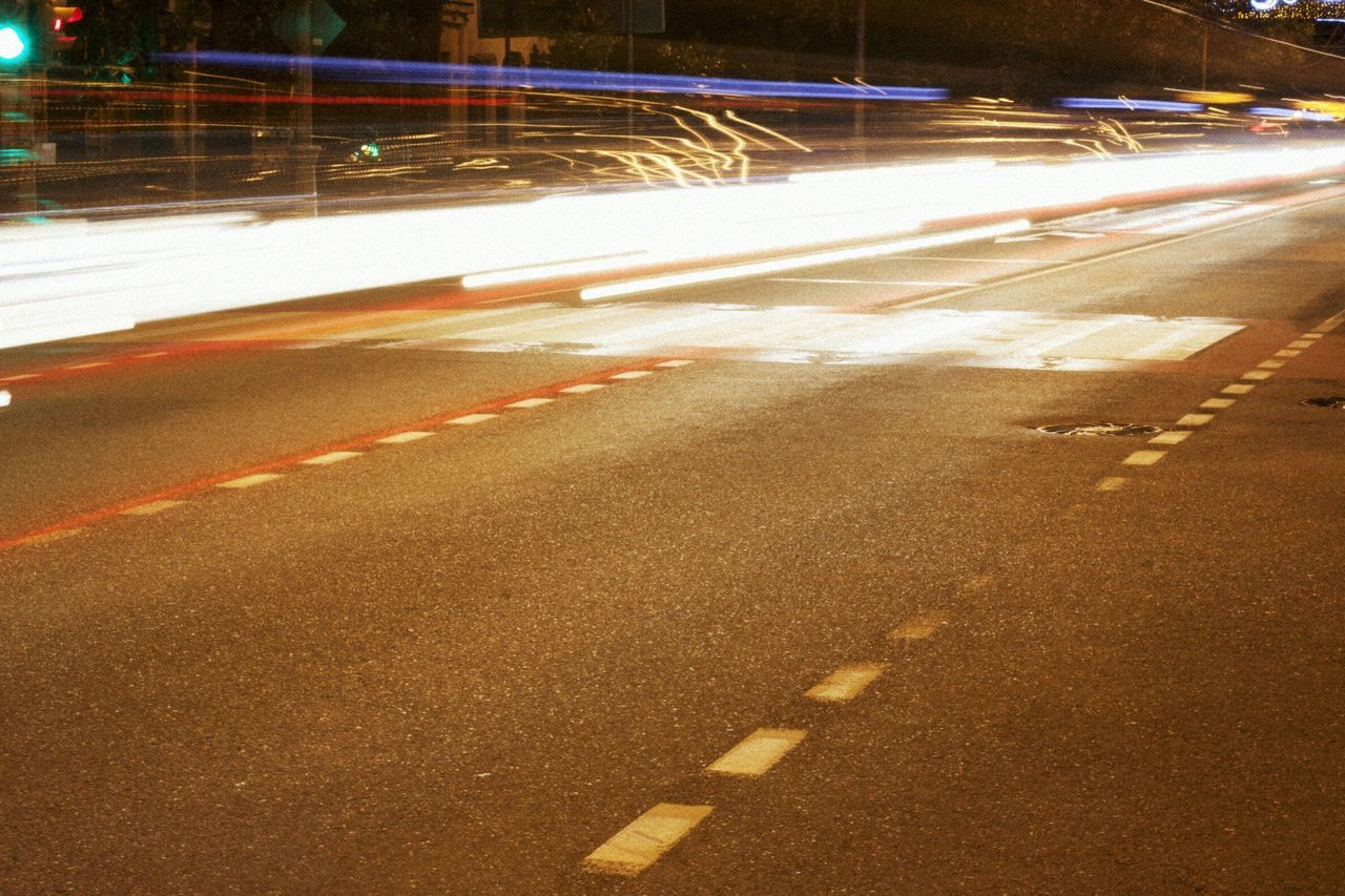 road, transportation, speed, motion, long exposure, city, light trail, street, illuminated, blurred motion, night, architecture, sign, no people, direction, symbol, traffic, road marking, marking, city life, cityscape, multiple lane highway