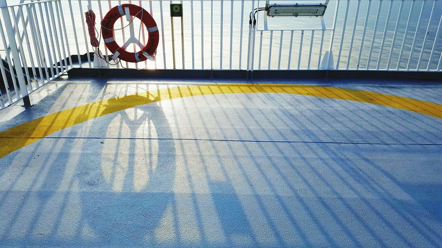 High angle view of life belt on boat deck