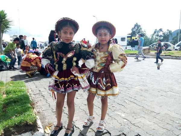 Child Childhood Children Only Dancing Day Ecuador Friendship Front View Full Length Leisure Activity Looking At Camera Outdoors People Portrait Quito Real People Sky Street Performer Togetherness Two People Walking