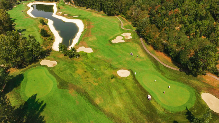 Adult Adults Only Aerial View Day Golf Golf Club Golf Course Golfer Grass Green - Golf Course High Angle View Landscaped Leisure Activity Outdoors People Sand Trap Scenics Sport Taking A Shot - Sport Tree