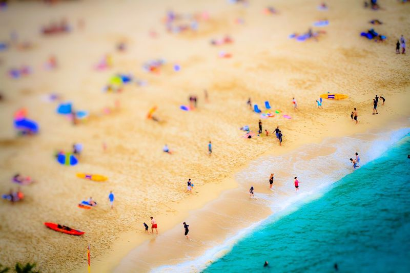 Tilt-shift image of people at beach