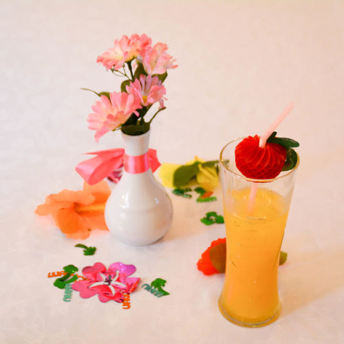 Close-up of multi colored flowers in vase on table