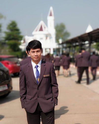 Portrait of university student wearing suit