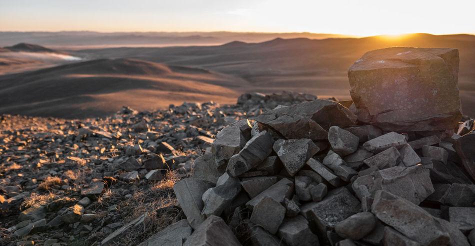 Hilltop Horizon Landscape Mongolia Outdoors Rocks Sky Smoke Steppe Sun Sunset EyeEmNewHere EyeEmNewHere Lumix Lx100