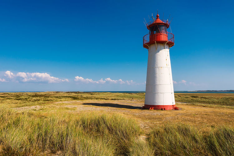 Lighthouse List-West Architecture Protection Summer Nature Security Building Lighthouse Day Outdoors Tower Grass Coast Deutschland Direction North Sea Leuchtturm Sylt Sylt, Germany Guidance Safety Lighthouse_lovers No People Copy Space Building Exterior Built Structure Lighthouse Tower Scenics - Nature Sylter Leuchttürme Eyeem Lighthouse Lovers Urlaub Auf Sylt
