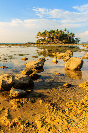 Lonely remote island with rock beach. Beautiful rocky coastline with full of stones on the beach when the sea water receded with dramatic blue sky background on the cloudy day. Coastline Coastline Landscape Coastline Nature Water Lonely Lonely Island Lonely Place  Peaceful View Rock Beach Sea Rocky Beach Rocky Coastline Rocky Shore Beach Beauty In Nature Cloud - Sky Coastline Sky Day Lonelyplanet Nature No People Outdoors Peaceful Peaceful Nature Peaceful Place Rock - Object Rock Beach Rocky Coast Rocky Landscape Scenics Sky Tranquil Scene Tranquility Tree Water