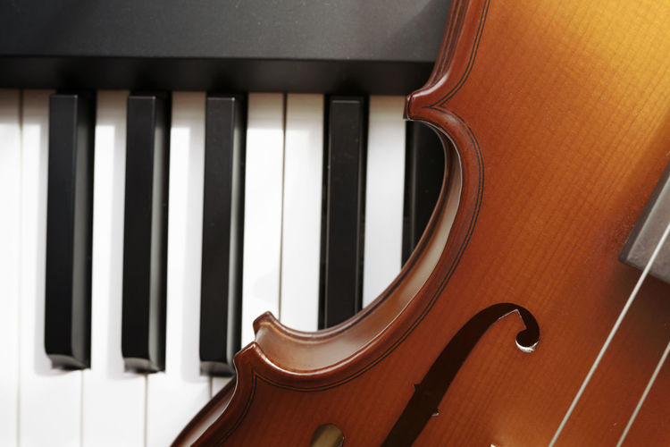 Piano keyboard with violin,top view Musical Instrument Musical Equipment Music Arts Culture And Entertainment String Instrument Piano Musical Instrument String No People Close-up String Indoors  Piano Key Wood - Material Violin Brown Still Life High Angle View Full Frame White Color Classical Music Keyboard Instrument