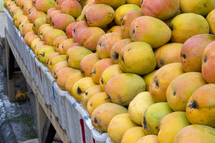 High angle view of mangos on market stall