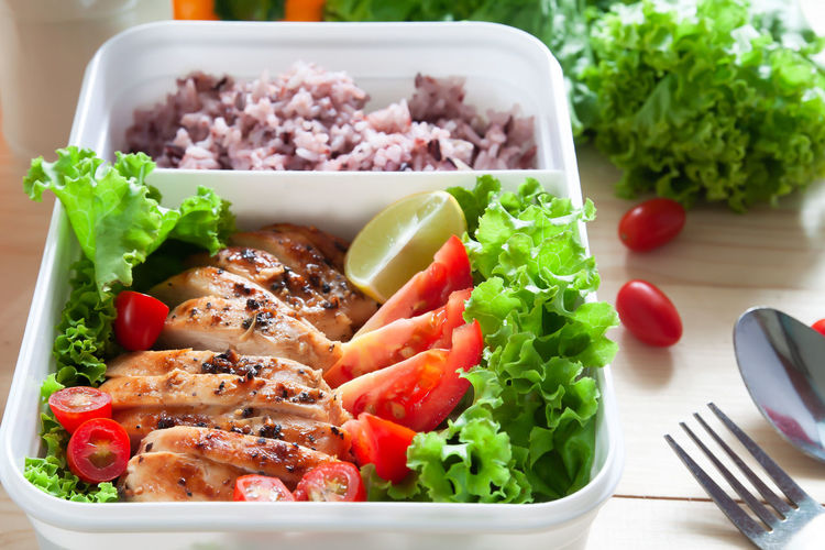 Grilled chicken with black pepper, tomatoes, lime and lettuce serve with rice in food container, Close up Breakfast Chicken Grilled Chicken Lunch Rice Close Up Close-up Food Food And Drink Freshness Health Healthy Eating Healthy Food Lunch Box Meal Meat No People Ready-to-eat Salad Serving Size Still Life Table Tomato Vegetable Wellbeing