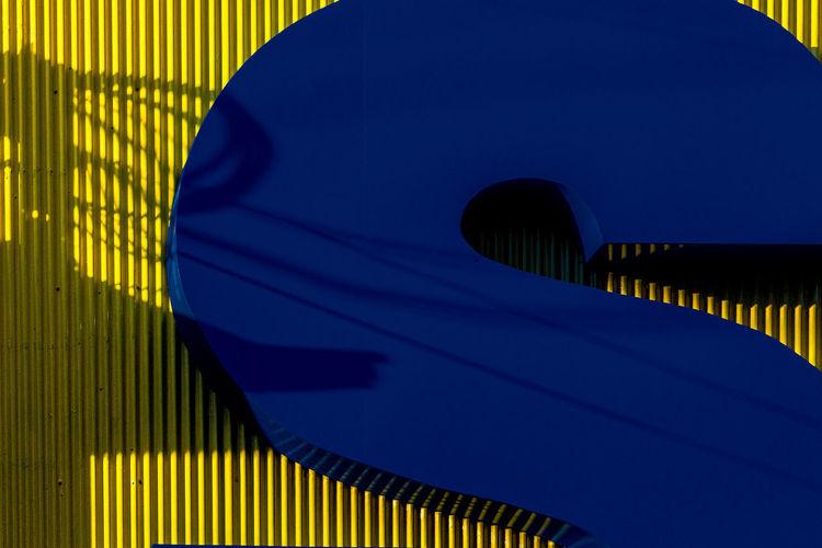 Close-up of modern bridge against blue sky