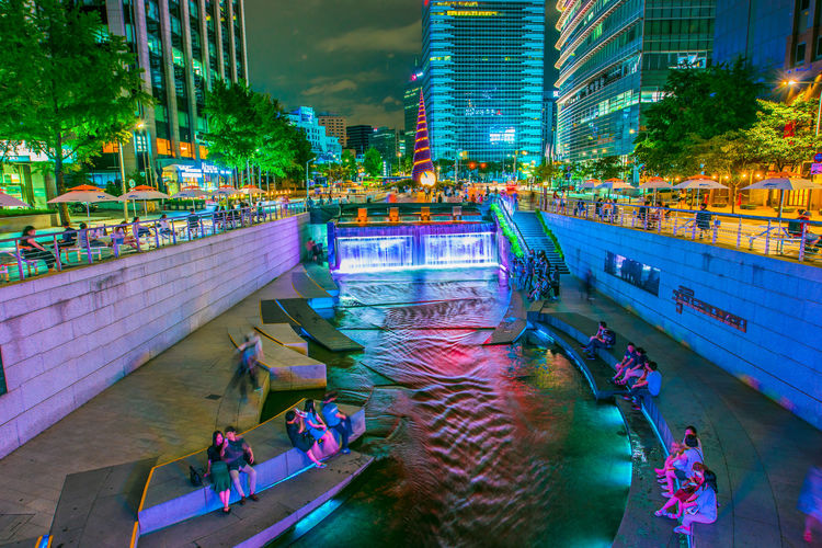 Seoul, South Korea - June 04, 2016: Cheonggyecheon Night in downtown Seoul, South Korea Architecture Building Exterior Built Structure Canal City Group Of People High Angle View Illuminated Nature Night Office Building Exterior Outdoors Real People Transportation Water