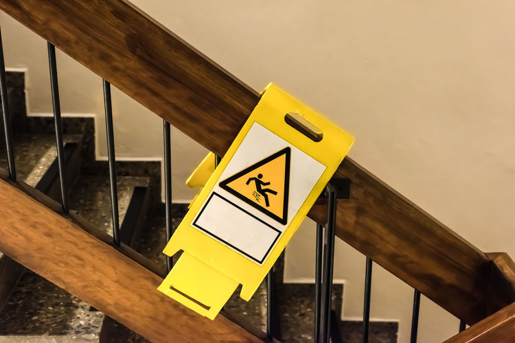 danger sign at a handrail in a staircase Cleaning Service Sign Stairs WIPED Accident Accidents And Disasters Advice Brush Built Structure Clean Communication Danger Dangerous Equipment Freshly Handrail  Insurance Job Maintainance Painful Slide Staircase Warning Warning Sign