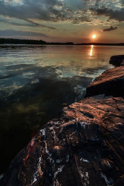 Outdoors Sun Sunset Sunlight Rock - Object Lake Horizon Over Water Nature Tranquil Scene Water Reflection Water Reflections