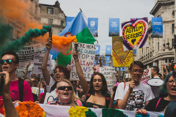 At London Pride 2017, protestors successfully held up the parade and marched in front of the parade in protest of the corporate sponsors. Sponsors of the event were accused of not supporting their LGBTQ+ workers as well as contributing to LGBTQ+ oppression around the globe. #NotYourCliche LGBTQ Rights London PrideIsAProtest Protest Smoke City Crowd Day Demonstration Equality Flag Group Of People Lgbt Loveislove March Outdoors Pride Parade Real People The Photojournalist - 2018 EyeEm Awards Love Is Love Love Is Love The Troublemakers