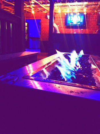 Blue Flames under Warm lights Outside Photography Local Bar colour of life Illuminated Arts Culture And Entertainment Multi Colored Close-up