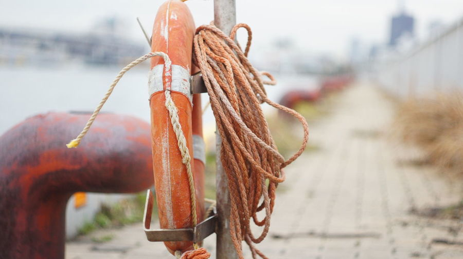 Close-Up Of Rope And Life Belt On Promenade