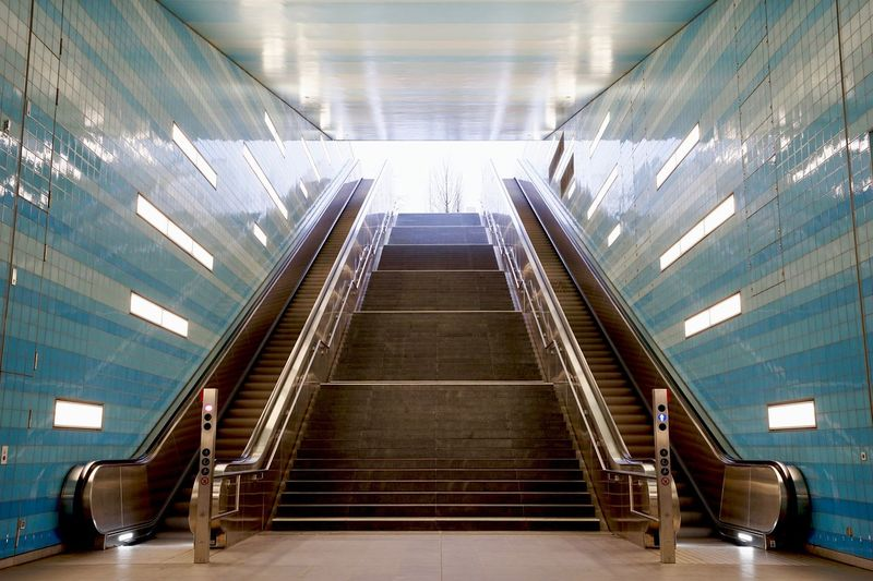 Empty steps and escalators in building