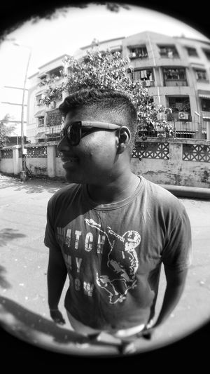 Portrait of boy wearing sunglasses in city